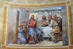 Mary Magdalene wipes the feet of Jesus. Saint Mary Magdalene wipes the feet of Jesus royalty free stock photos