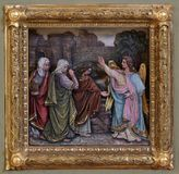 Mary Magdalene and women at the empty tomb of Jesus on day of Resurrection. Relief on the baptismal font, church of Saint Matthew in Stitar, Croatia royalty free stock images