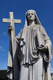 Mary (mother of Jesus) and cross Stock Photography