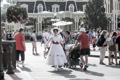 Mary Poppin's Walking in Magic Kingdom. Royalty Free Stock Photos