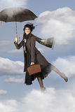 Mary Poppins flies on an umbrella Stock Photography