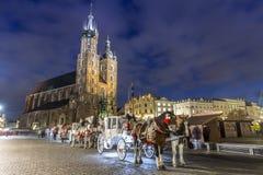Mary`s Church and white carriage, Krakow, Poland. Mary`s Church and white carriage in historic Krakow, Poland Stock Photography