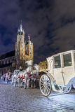 Mary`s Church and white carriage, Krakow, Poland. Mary`s Church and white carriage in historic Krakow, Poland Royalty Free Stock Images