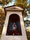A Mary Statue in an autumn park stock photography