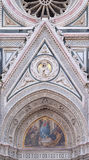 Mary surrounded by Florentine Artists, Merchants and Humanists, Portal of Florence Cathedral Stock Photos
