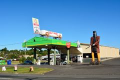 Gas station in Maryborough, QLD, with statue of Ned Kelly. Maryborough, Queensland, Australia - December 20, 2017. Gas station in Maryborough, QLD, with stock photos