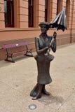 Statue of umbrella-wielding Mary Poppins in Maryborough, QLD. Maryborough, Queensland, Australia - December 21, 2017. Life-size bronze statue of umbrella stock photo