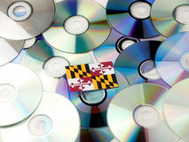 Maryland flag on top of CD and DVD pile isolated on white. Maryland flag on top of CD and DVD pile isolated Stock Image
