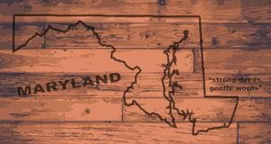 Maryland Map Brand. Maryland state map brand on wooden boards with map outline and state motto Stock Image