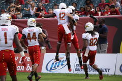 Maryland players jump high to celebrate a touchdown Royalty Free Stock Photography