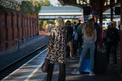 Crowd of people looking for train which still hasn`t arrived at the platform stock photography