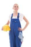 Marzący kobiety w błękitnym budowniczym munduruje mienie hełma żółtego iso Zdjęcie Stock