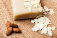Marzipan and almonds on wooden surface Stock Images