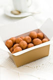 Marzipan balls in gift box Stock Photos