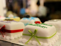 Marzipan Covered Decorated cakes in display Royalty Free Stock Photo