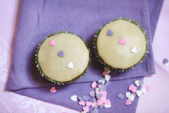 Marzipan cupcakes with heart decorations, two a couple Royalty Free Stock Photos