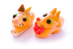 Marzipan dog and cat. On white backgound stock image