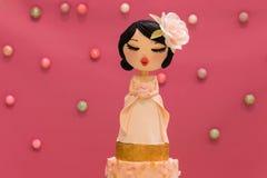 Marzipan doll on wedding cake Stock Image