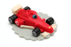 Marzipan formula one car. On white background Stock Images