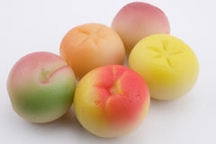 Marzipan fruits. Colourful marzipan fruits on white background Royalty Free Stock Photography
