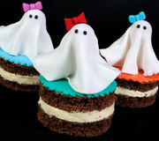 Marzipan ghosts on the cake Stock Photos
