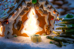 Marzipan gift near gingerbread cottage Stock Photography