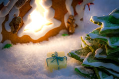 Marzipan gift under the gingerbread Christmas tree Royalty Free Stock Photography