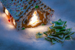 Marzipan gift under the gingerbread Christmas tree Stock Photos