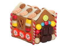 The marzipan house. A handmade fimo marzipan house, with cookies, candies, fruits and flowers royalty free stock image