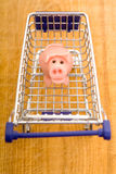 Marzipan pig in shopping cart Stock Photos