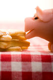 Marzipan pig tasting cookies Royalty Free Stock Images