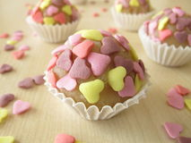 Marzipan pralines with sugar hearts Royalty Free Stock Photo
