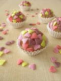Marzipan pralines with sugar hearts Royalty Free Stock Photography