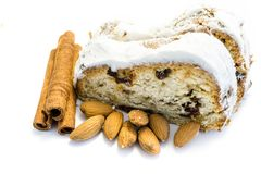 Marzipan stollen with cinnamon sticks and almonds isolated on white Background stock images