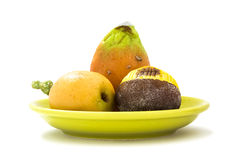 Marzipan sweets. Chestnut, prickly pear, tomato, medlar on a green dish Royalty Free Stock Photography