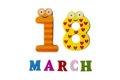 18 marzo su fondo, sui numeri e sulle lettere bianchi Fotografia Stock