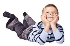 marzycielska chłopiec podłoga Zdjęcia Royalty Free