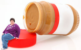 masła szczęśliwego słoju overwieghtwoman arachidowy obsiadanie Zdjęcie Stock