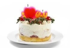 masło śmietanki tort z truskawką & świeczką na talerzu Obrazy Royalty Free