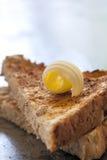 Masło kędzior na grzance obraz stock