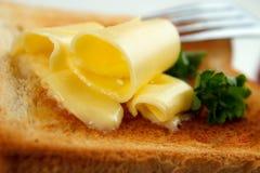 Masło stacza się zbliżenie Obrazy Royalty Free