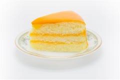 Masło tort z pomarańczowym źródłem na wierzchołku zdjęcie royalty free