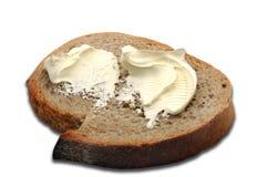 Masło na plasterku chleb Fotografia Stock