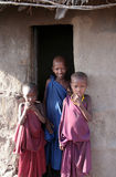 Masaai Children in the Boma. Three Masaai  children standing at the door of one of the huts in their boma. Taken at, Manyara Lake area, North Tanzania, Tanzania Royalty Free Stock Photo