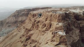 Masada - Aerial footage of the ancient fortification in the Southern District of Israel. Moving forward. Flying around stock footage