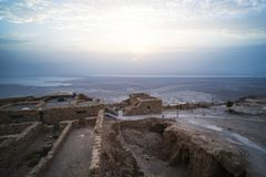 Masada is an ancient fortress off the southwestern coast of the Dead sea, in Israel. Near the city of Arad, at the Ein Gedi Ein. Bokek highway. Sunrise in the stock photo