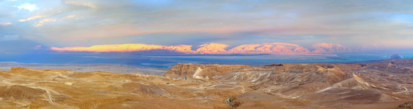 Masada and the Dead Sea, Israel. A panoramic view of the famous Masada fortress with the Dead Sea and Jordan Red Mountains in the background, Israel Stock Image