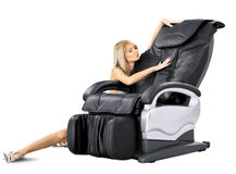 Masage01. Isolated massage chair whith nice girl on white Royalty Free Stock Image