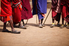 Masai. Group of masai people participating in traditional dance with high jumps Stock Photo