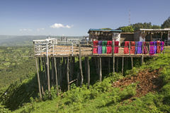Masai blankets hang on deck overlooking Great Rift Valley in springtime, Kenya, Africa Stock Images